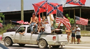 Protesters display Confederate flags United States flags from the bed of a pickup truck May 6 on a highway about 15 miles south of Miami in what organizers said was a protest to show support for Attorney General Janet Reno and respect for the flag. Organizers said they wanted to counteract demonstrations held by members of the Cuban-American community that followed the April 22 seizure of Cuban rafter Elian Gonzalez by government agents from the home of his Miami relatives. BC/CLH/